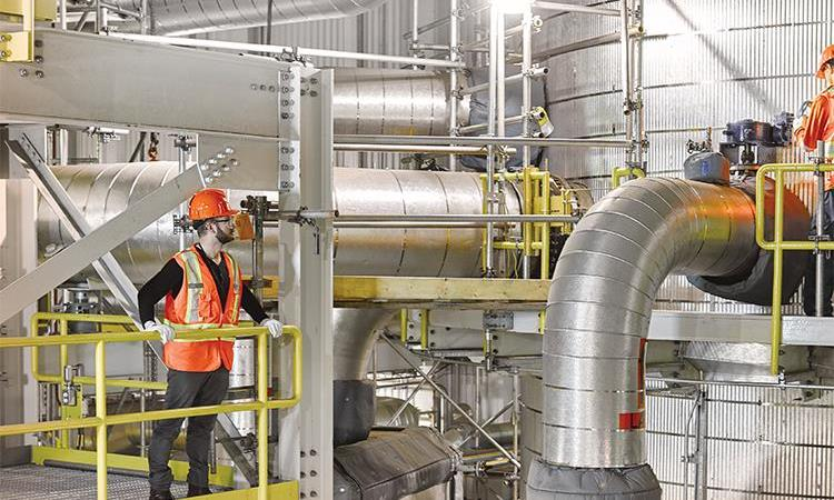 Employees working inside the Carbon Capture facility.